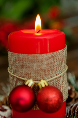 chandelier: Candle for Christmas in red. Beautiful Holidays decoration