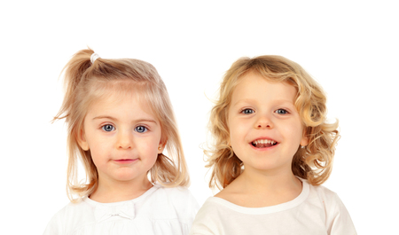 Funny blond twins isolated on a white background