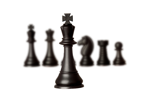 battle plan: Black chess team with the king close-up isolated on a white background
