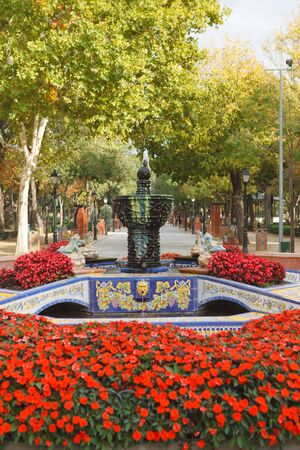 Beautiful park in Spain with many red flowers and a font Stock Photo