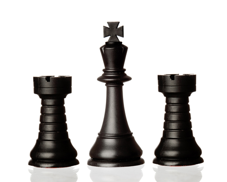 battle plan: Black chess pieces isolated on a white background