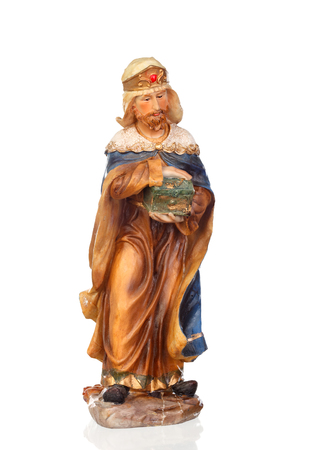 Melchor, one of the three wise men. Ceramic figure isolated on white background