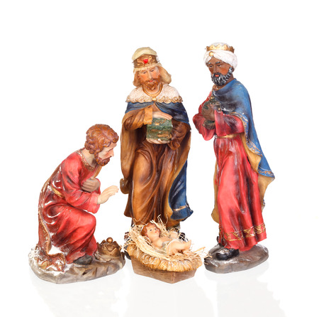 The three wise men and baby Jesus. Ceramic figures isolated on white background Stock Photo
