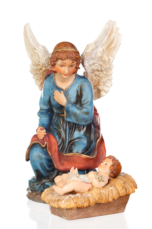 Ceramic figure of The Baby Jesus and the angel of the nativity scene isolated on a white background Banque d'images