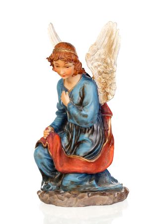 Ceramic figure of the angel of the nativity scene isolated on a white background Stock Photo
