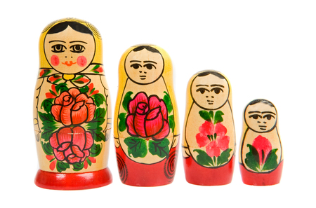 Russian matryoshka dolls in a row isolated on white Stock Photo