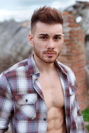 Attractive guy with the plaid shirt unbuttoned