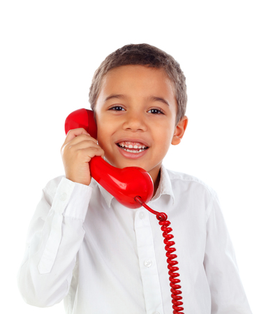 Funny small child talking on the phone isolated on a white background Stock Photo