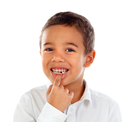 Latin child showing his new teeth isolated on a white background 免版税图像