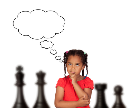 Beautiful child thinking about the chess strategy to follow