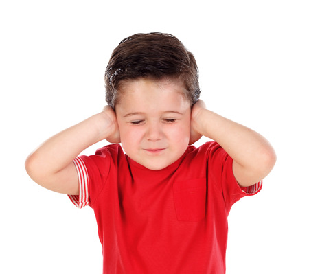 Small child covering his ears isoalted on a white background Foto de archivo - 99909473