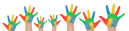 Children's hands full of paint isolated on a white background Foto de archivo