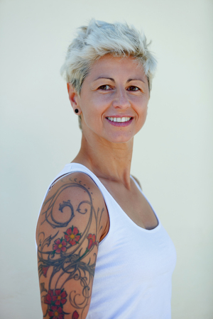 Blonde woman with flowered tattoos on her arm