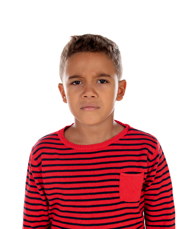 Sad child with red striped t-shirt isolated on a white background Standard-Bild