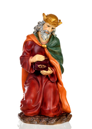 Melchor, one of the three wise men. Ceramic figure isolated on white background 免版税图像 - 112623421