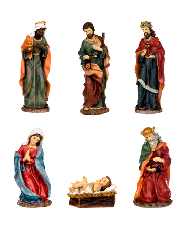 Ceramic figures for the nativity scene isolated on a white background Imagens