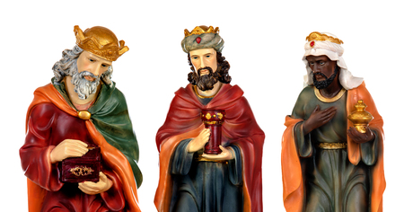 The three wise men and baby Jesus. Ceramic figures isolated on white background
