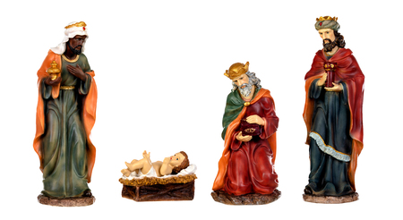 The three wise men and baby Jesus. Ceramic figures isolated on white background Imagens