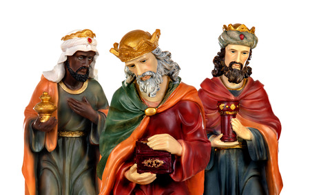 The three wise men and baby Jesus. Ceramic figures isolated on white background Stok Fotoğraf