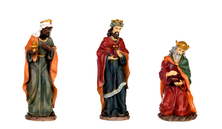 The three wise men and baby Jesus. Ceramic figures isolated on white background Reklamní fotografie