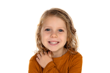 Happy blond child with long hair isolated on a white background Imagens