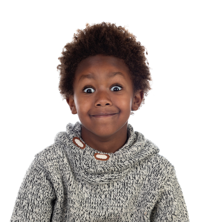 Funny expression of a small african child isolated on a white background