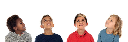 Four happy children looking up isolated on a white backround Stockfoto - 114637140
