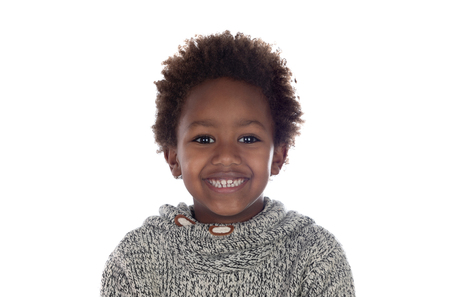 Beautiful Afro-American child with grey wool jersey isolated on a white background