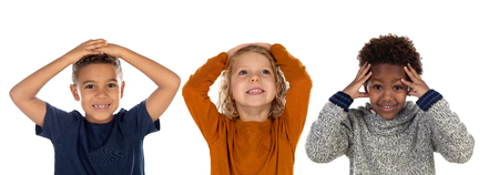 Three small children covering their mouths isolated on a white background Фото со стока