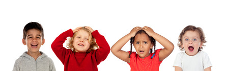 Surprised children covering their head and other laughing isolated on a white background