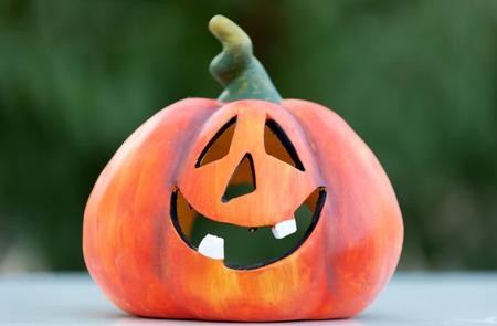 Happy pumpkin outside with a funny smile Archivio Fotografico