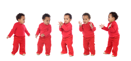 Five happy babies dancing and claping isolated on a white background 版權商用圖片