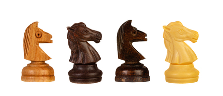 Four different chess knights isolated on a white background Banque d'images - 119652094
