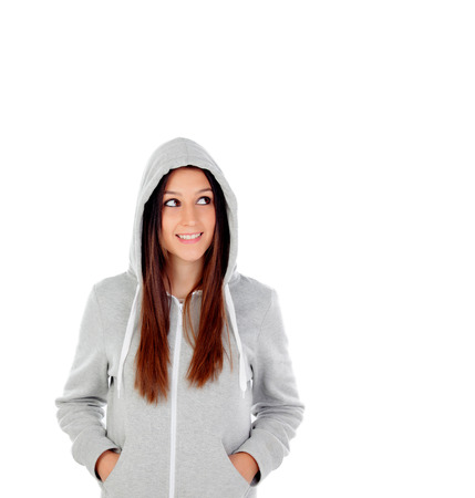Pensive hooded girl with grey sweatshirt looking at side isolated on a white background