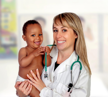 Pretty blonde pediatrician with a beautiful African American baby in arms in the hospital