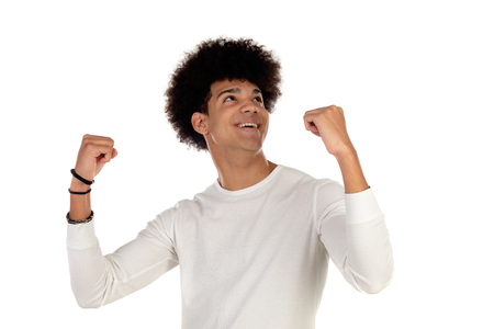 Happy afro guy celebrating something isolated on a white background