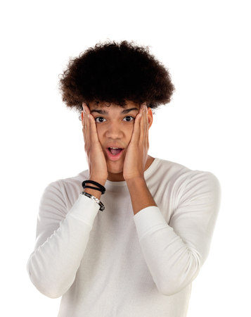 Surprised guy with afro hairstyle isolated on a white background 免版税图像