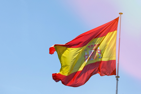 Spain flag waving in the wind on the blue sky Stock Photo - 123696726