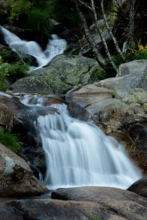 Beautiful waterfall falling on the stones