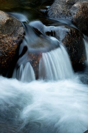 Beautiful waterfall falling on the stones