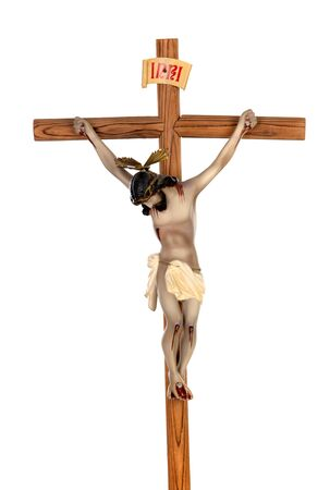Cross Jesus Christ. Plaster figure on a blue background