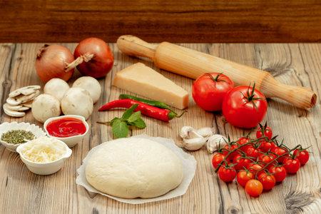 Ingredients for a healthy pizza in the kitchen Zdjęcie Seryjne