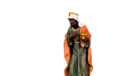 Baltasar, one of the three wise men. Ceramic figure isolated on white background