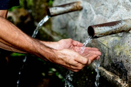 Source of two pipes with crystal clear water of the mountain Stok Fotoğraf