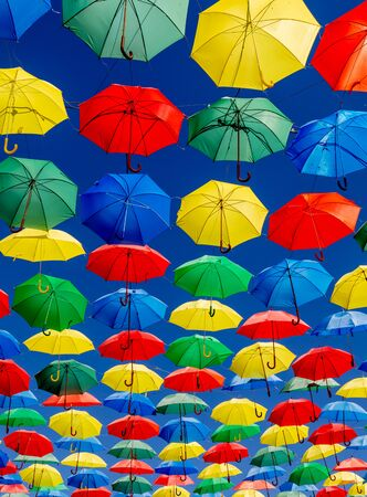 Colorful umbrellas on the sky to give shadow for the street