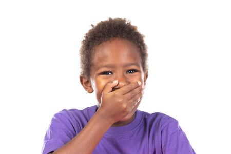 Surprised child covering his mouth isolated on a white background