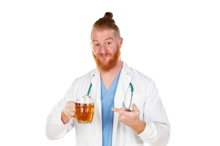 Redhead doctor drinking a beer isolated on a white background