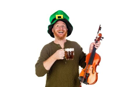 Redhead man with green hat and a violin drinking a beer isolated on a white background