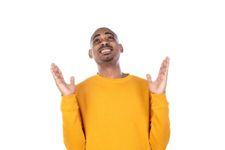 Afroamerican guy wearing a yellow jersey isolated on a white background 版權商用圖片