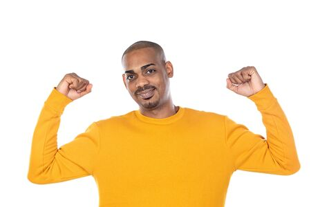 African guy with yellow T-shirt isolated on a white background Stok Fotoğraf